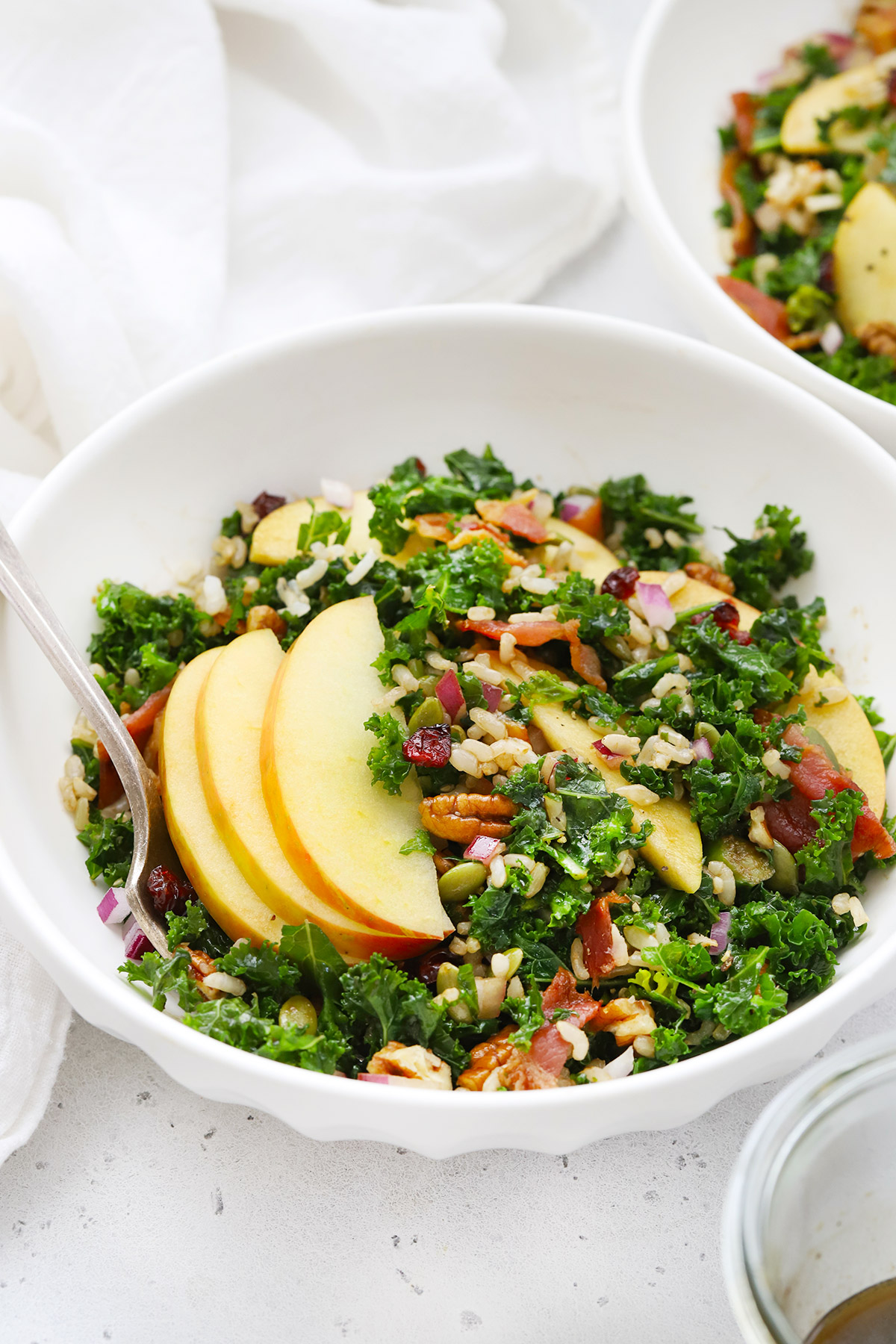 Front view of bowls of Harvest Apple Kale Salad with Balsamic Dressing
