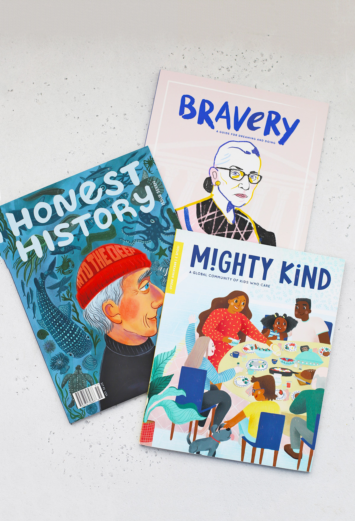 3 Kids Magazines on a White Background. Bravery Magazine, Honest History, and Mighty Kind Magazines.