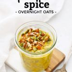"Jar of pumpkin overnight oats topped with pecans and pumpkin seeds with text overlay that reads ""gluten-free + vegan Pumpkin spice Overnight Oats"""