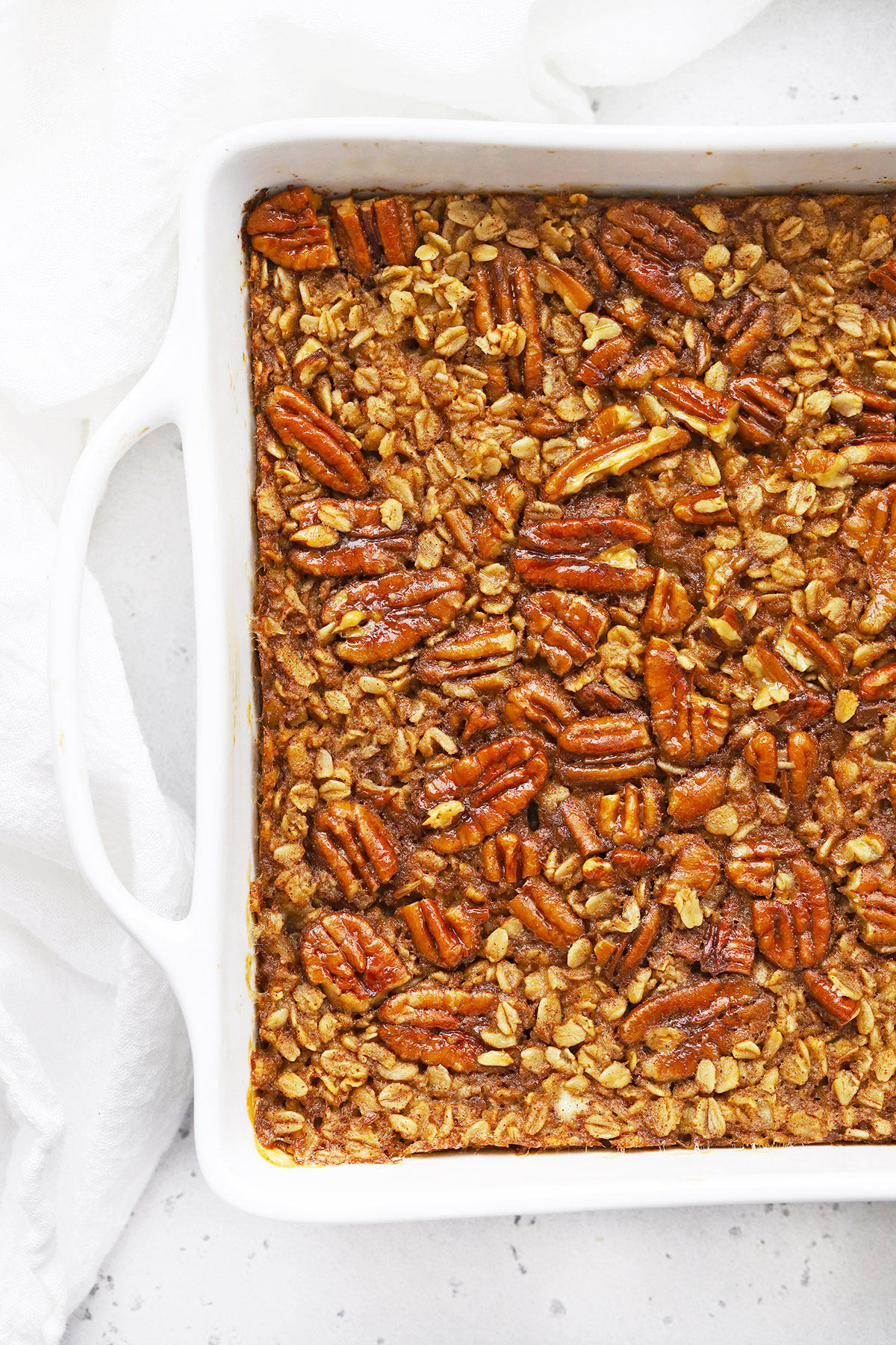 Close up view of a pan of pecan pie baked oatmeal.