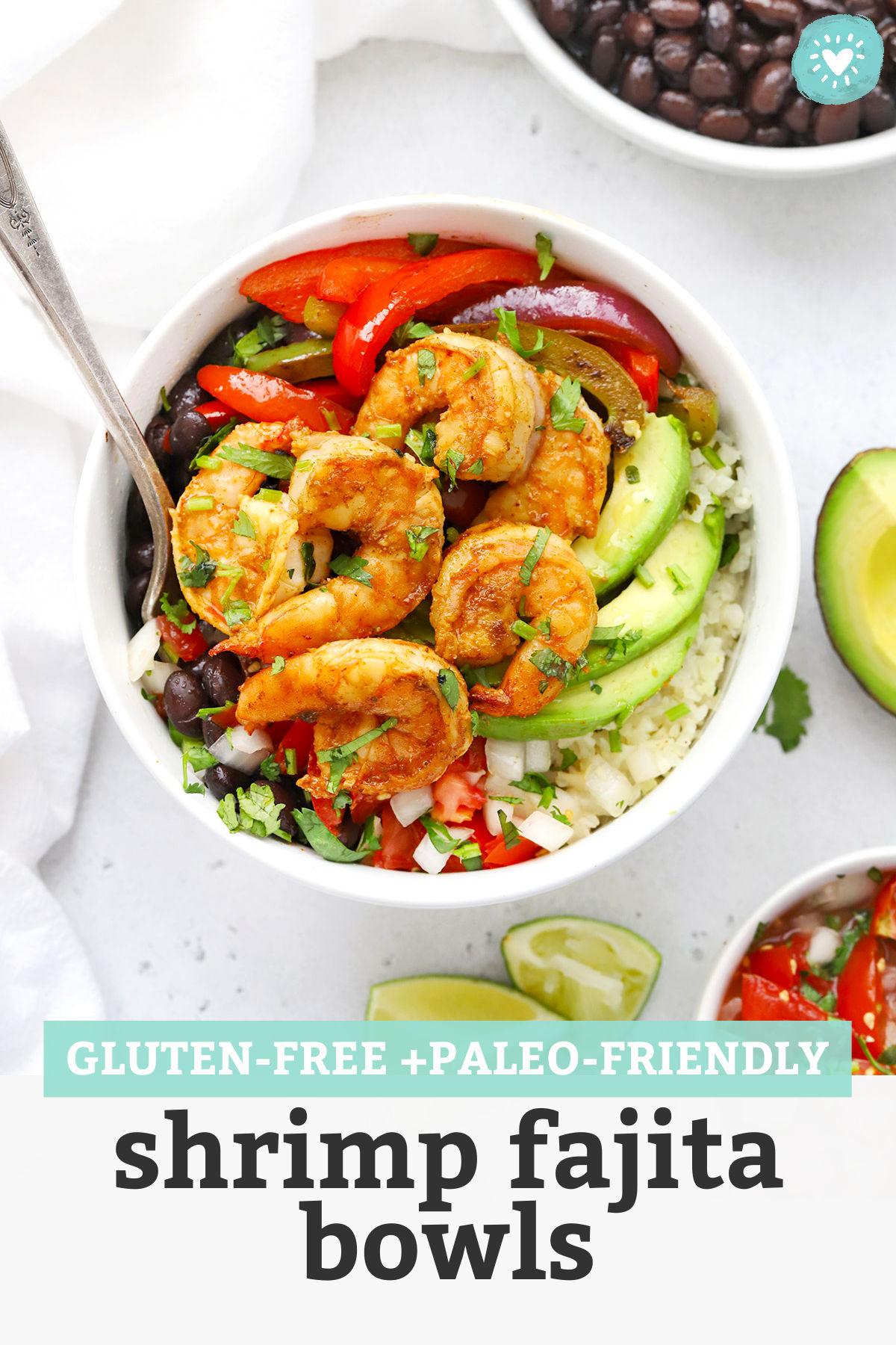 "Overhead view of Gluten Free Shrimp Fajita Bowls with avocado, black beans, and pico de gallo with text overlay that reads ""Gluten-Free + Paleo-Friendly Shrimp Fajita Bowls"""
