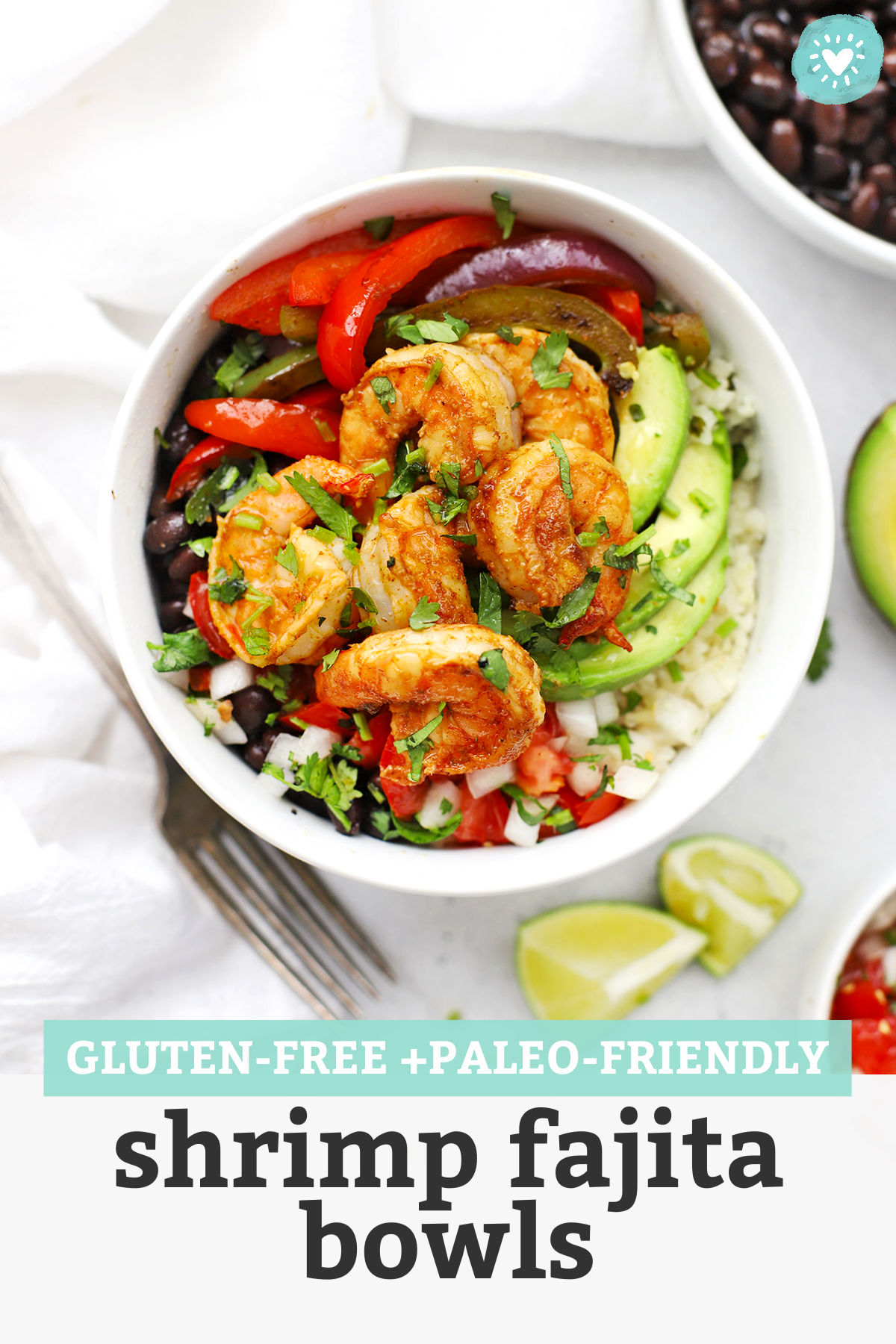 "Gluten Free Shrimp Fajita Bowls with avocado, black beans, and pico de gallo with text overlay that reads ""Gluten-Free + Paleo-Friendly Shrimp Fajita Bowls"""