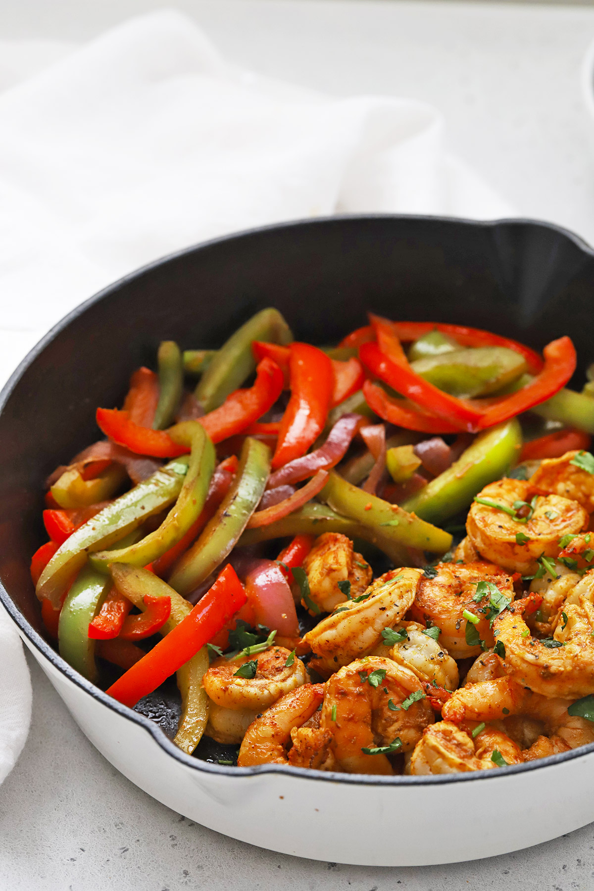 Front view of shrimp fajitas in a cast iron pan