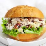 Close up front view of an Apple Cranberry Chicken Salad Sandwich on a Gluten-Free Bun with Lettuce