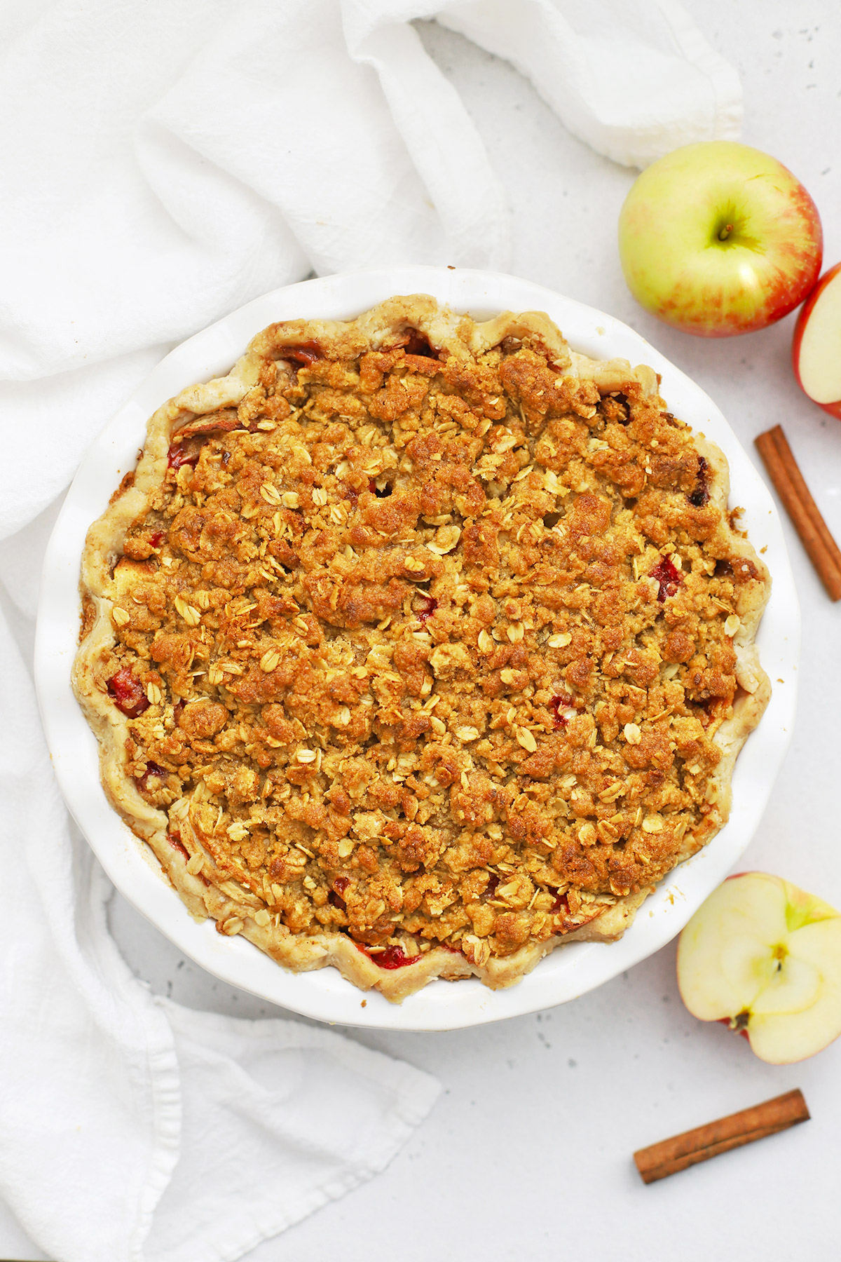Overhead view of an Apple Cranberry Crumble Pie on a white background