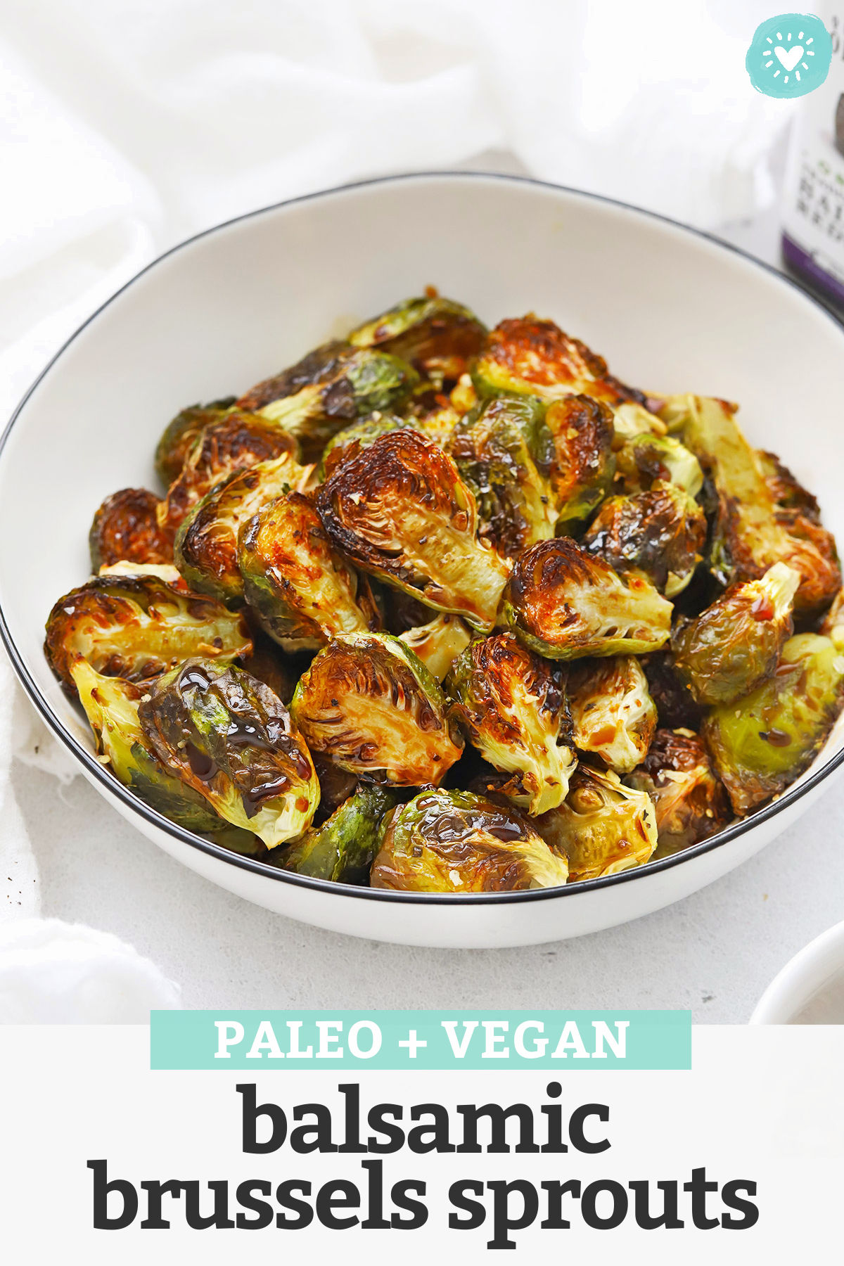Balsamic Brussels Sprouts - Crispy roasted balsamic Brussels Sprouts with balsamic glaze make a delicious side dish you'll come back to again and again. (Paleo, Vegan) // Maple Balsamic Brussels Sprouts // Roasted Brussels Sprouts recipe // Thanksgiving side dish #paleo #vegan #brusselssprouts #sidedish #thanksgiving