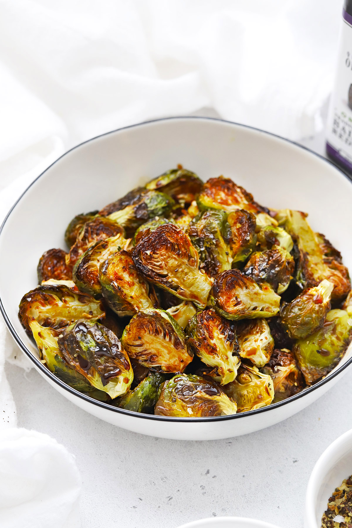 Front view of a bowl of roasted balsamic Brussels sprouts