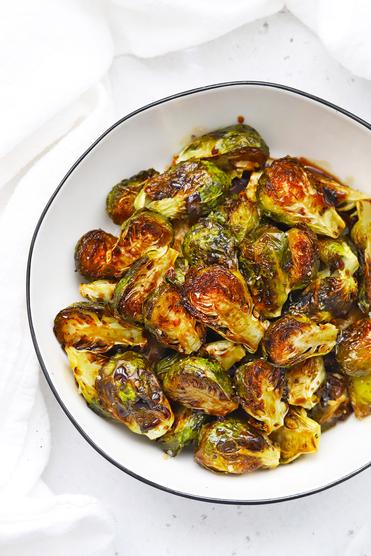 Overhead view of a bowl of roasted balsamic Brussels sprouts