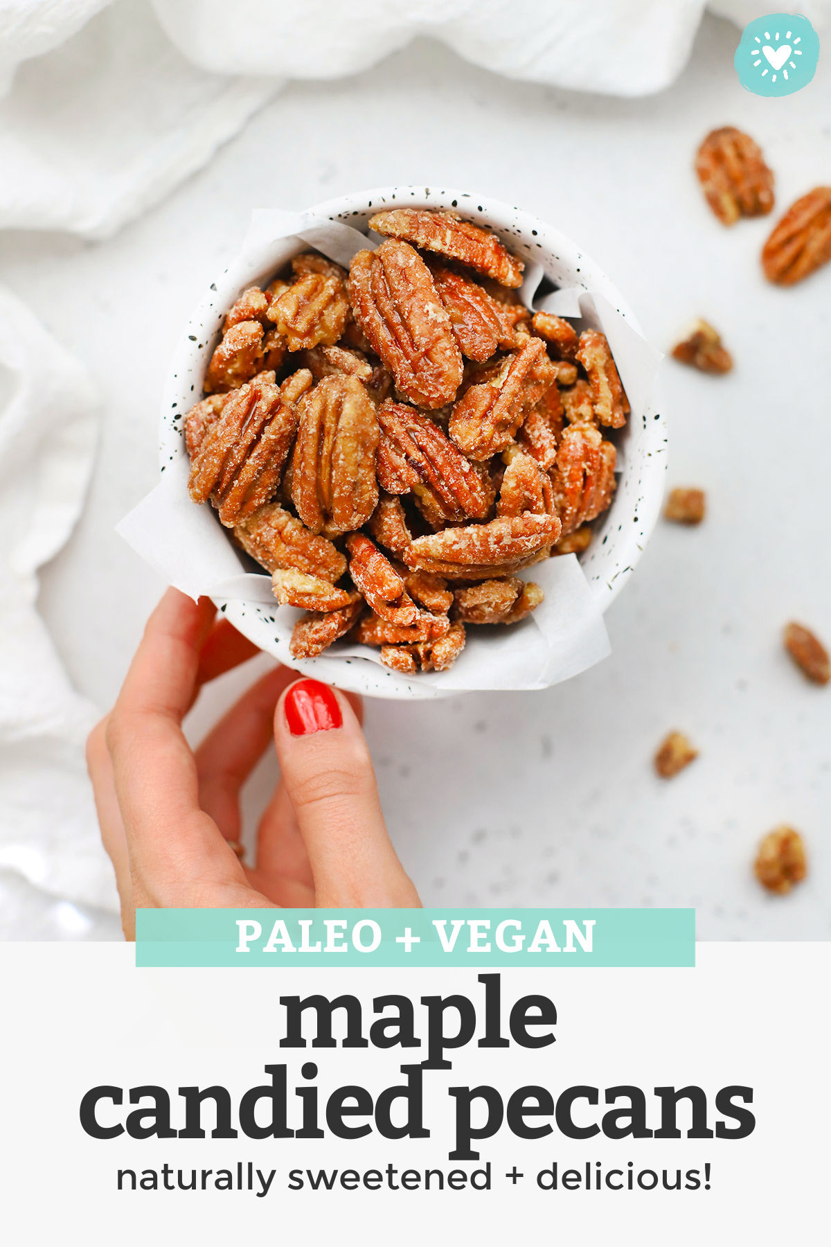 Maple Candied Pecans - These naturally sweetened candied pecans are PERFECT for snacking, holiday gifting, or topping your favorite salad. You'll love them as much as we do! Don't forget the free printable gift tag for gifting! (Paleo + Vegan) // Paleo Candied Pecans // Healthy Candied Pecans // Edible Gift // Holiday Gift // Printable Gift Tag // Cinnamon Candied Pecans #candiedpecans #ediblegift #holidaygift #gifttag