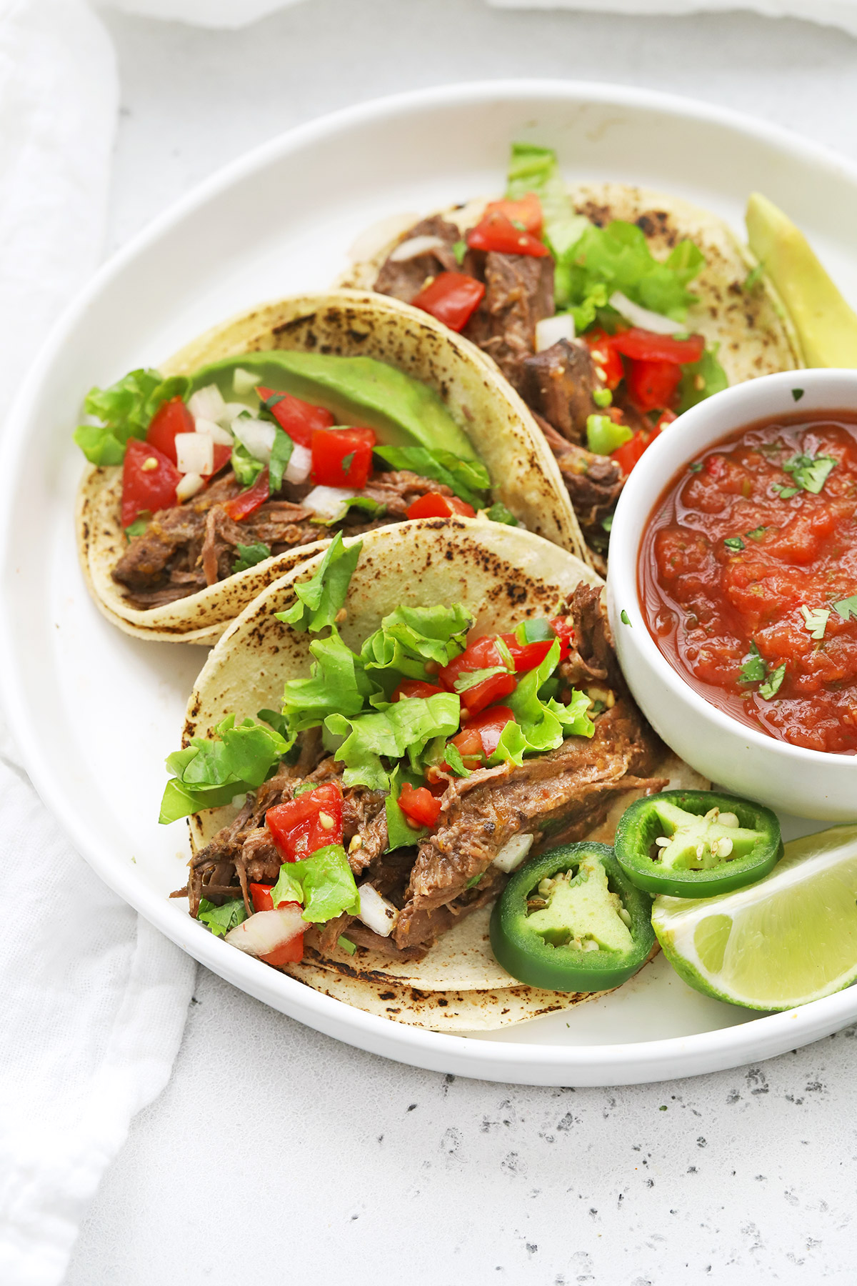 Front view of Slow Cooker Barbacoa Beef Tacos (Gluten-Free + Delicious)