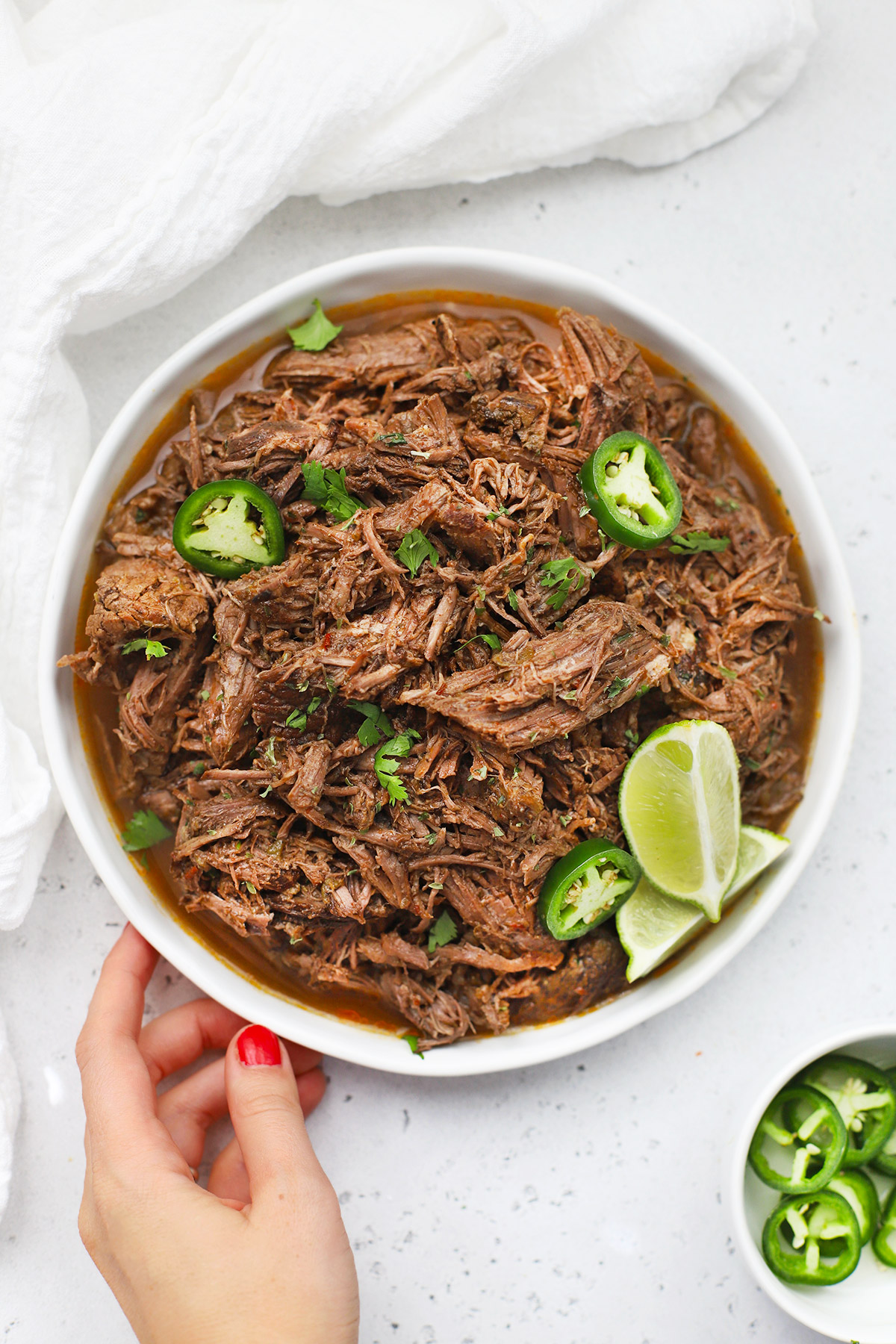 Overhead view of a plate of Slow Cooker Barbacoa Beef (Gluten-Free + Paleo)