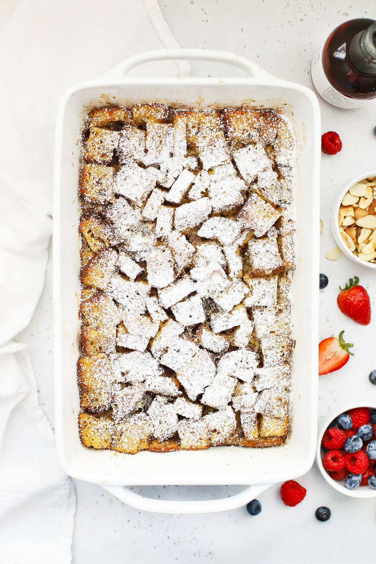 Overhead view of overnight gluten-free french toast casserole topped with powdered sugar