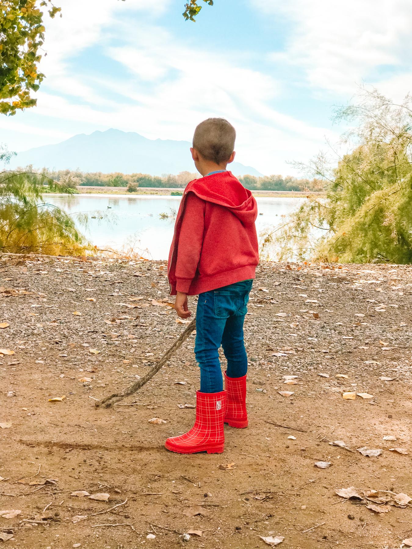 Little boy wearing red trafalgar boots from London Littles