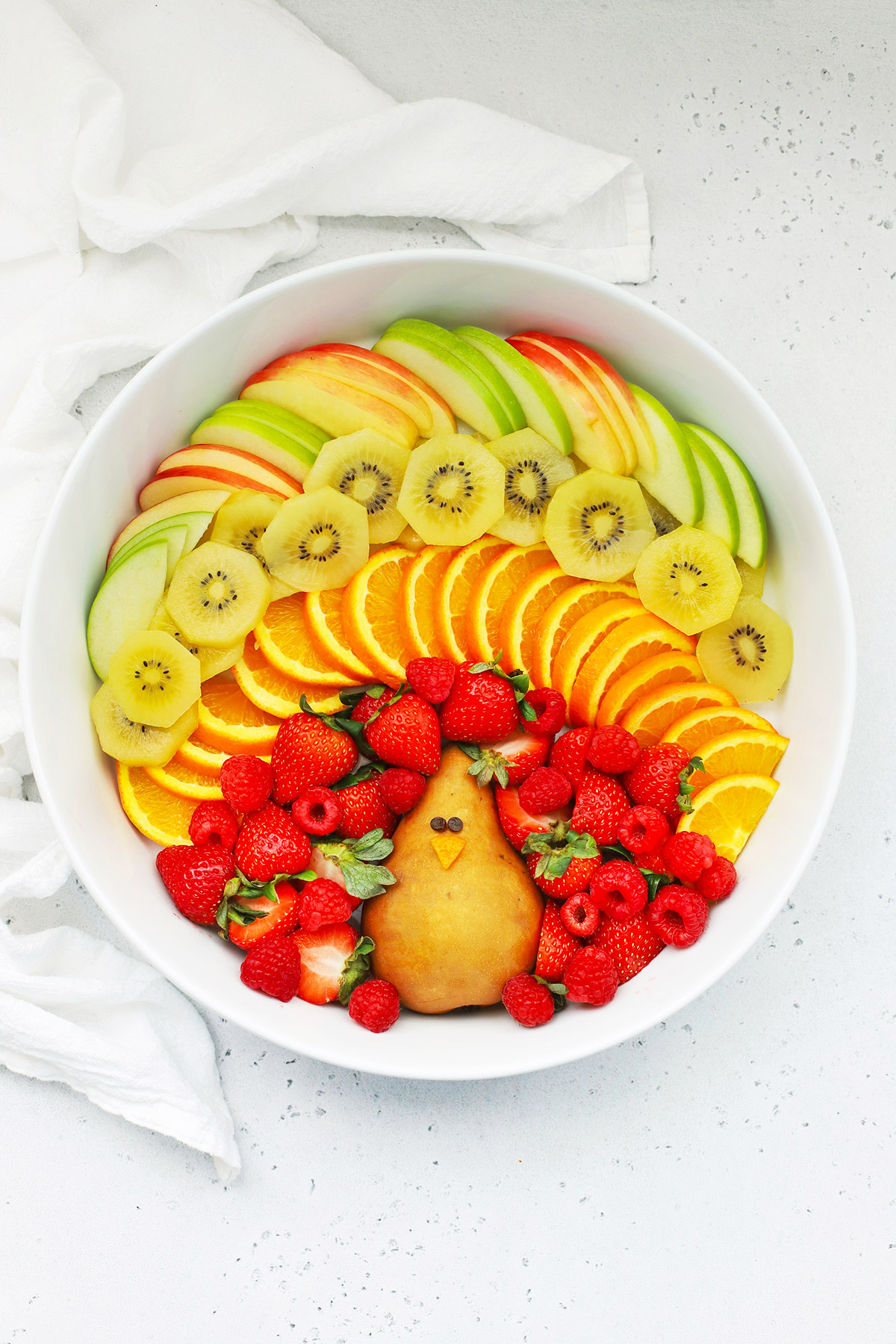Overhead view of a turkey-shaped fruit platter