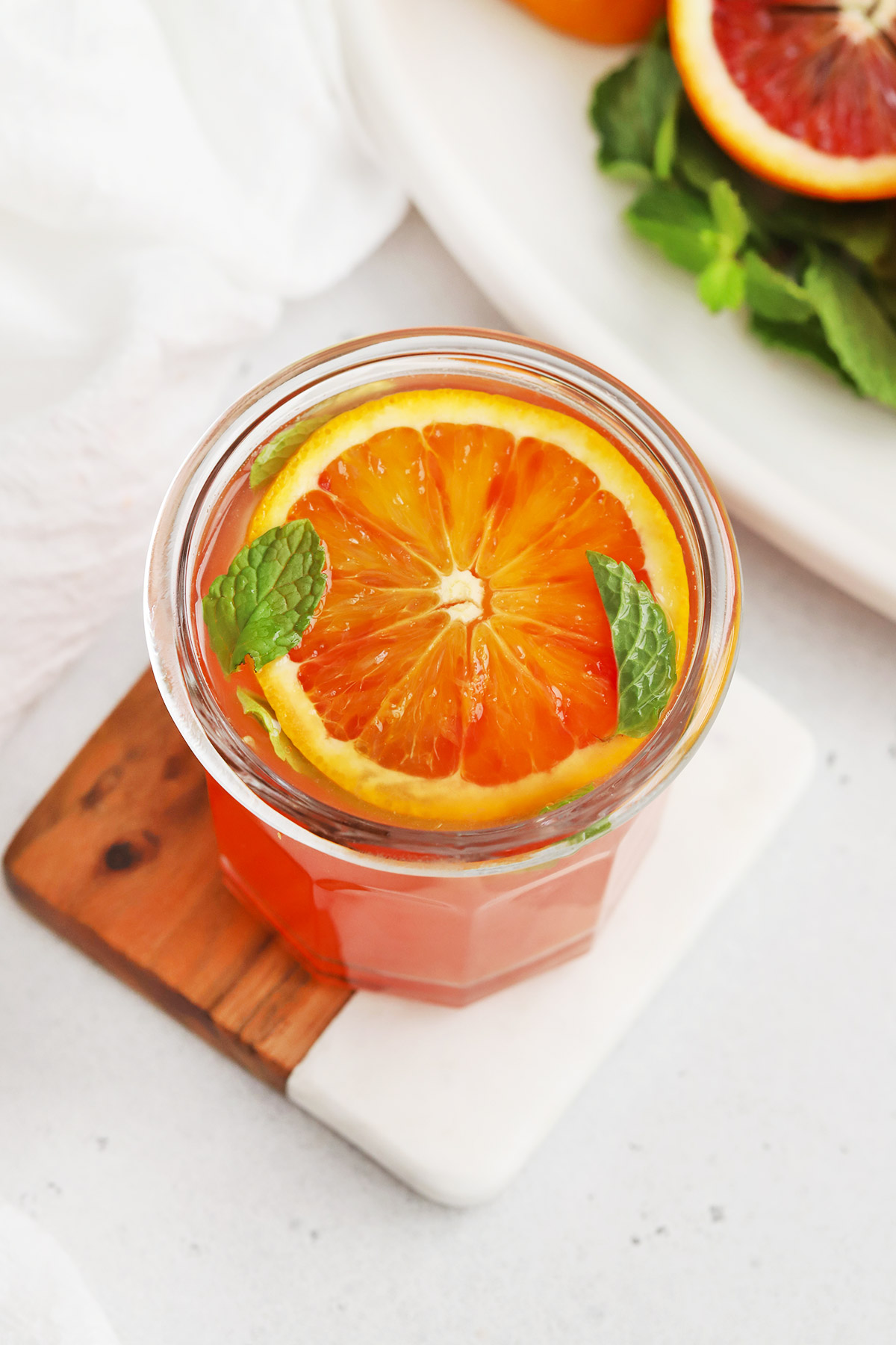 Front view of a blood orange mocktail garnished with fresh mint