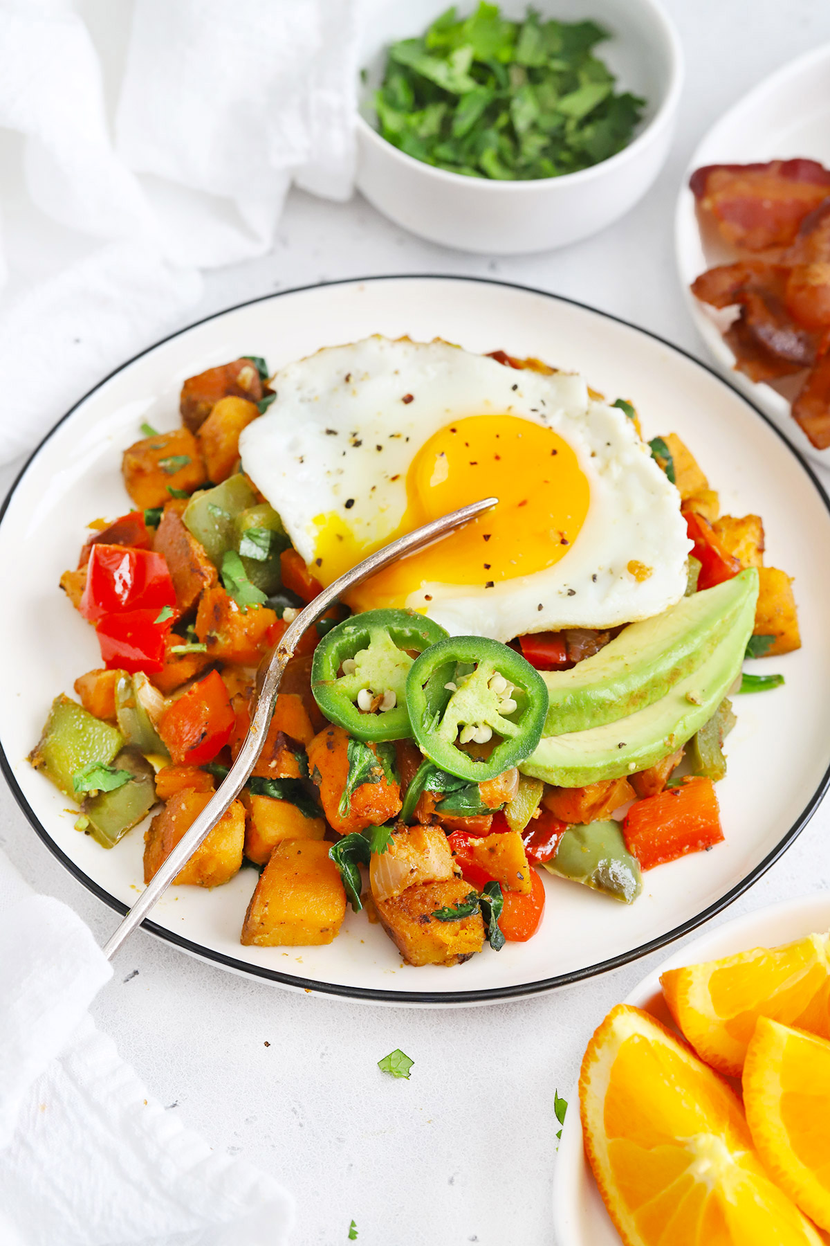 Front view of a plate of Vegan Sweet Potato Hash topped with an egg