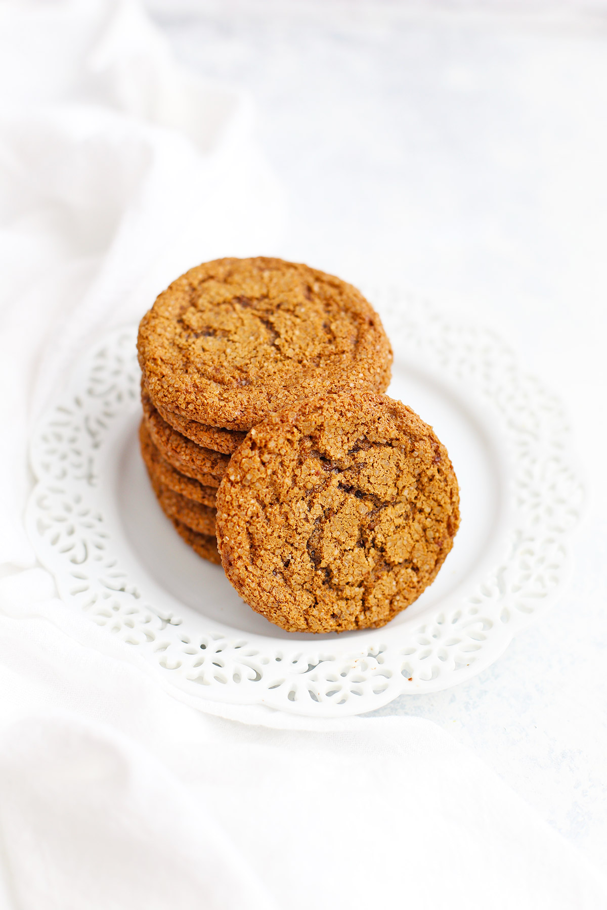Paleo ginger cookies on a white snowflake plate from One Lovely Life