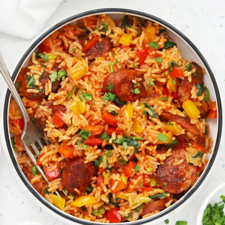 Overhead view of a bowl of Cajun Sausage and Rice Skillet on a white background