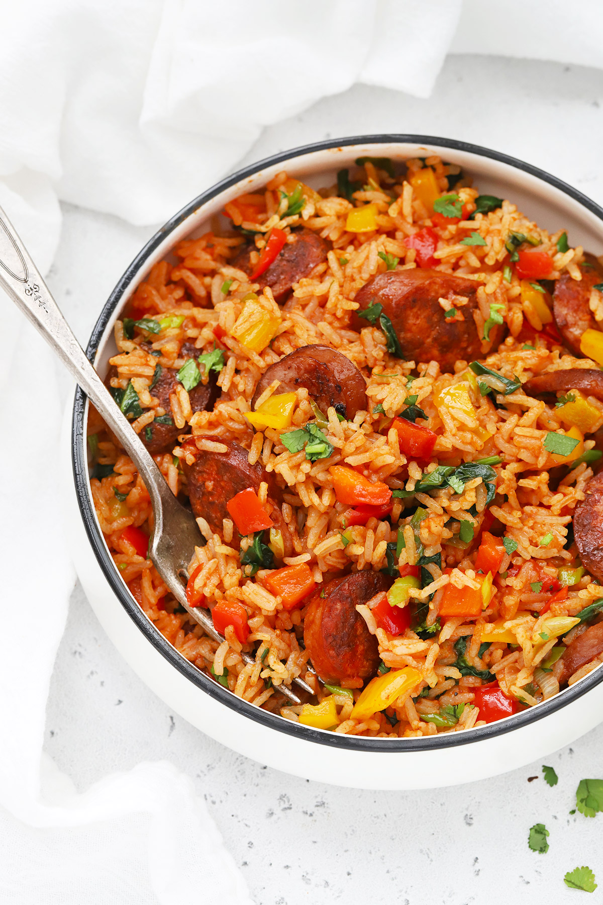Front view of a bowl of Cajun Sausage and Rice Skillet on a white background