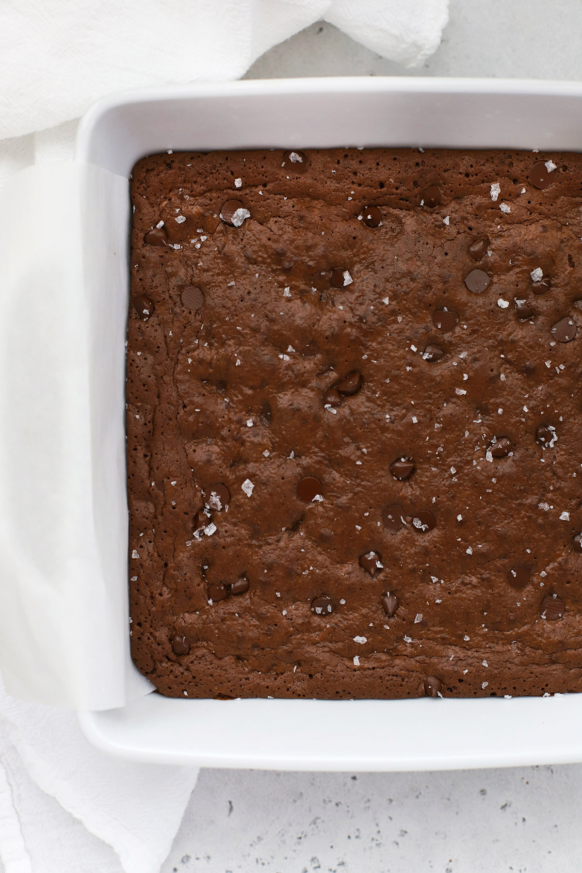 Overhead view of a white baking dish with gluten-free brownies after baking