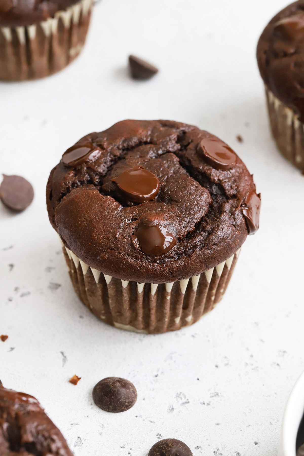 Close up view of a gluten-free chocolate banana muffin with chocolate chips