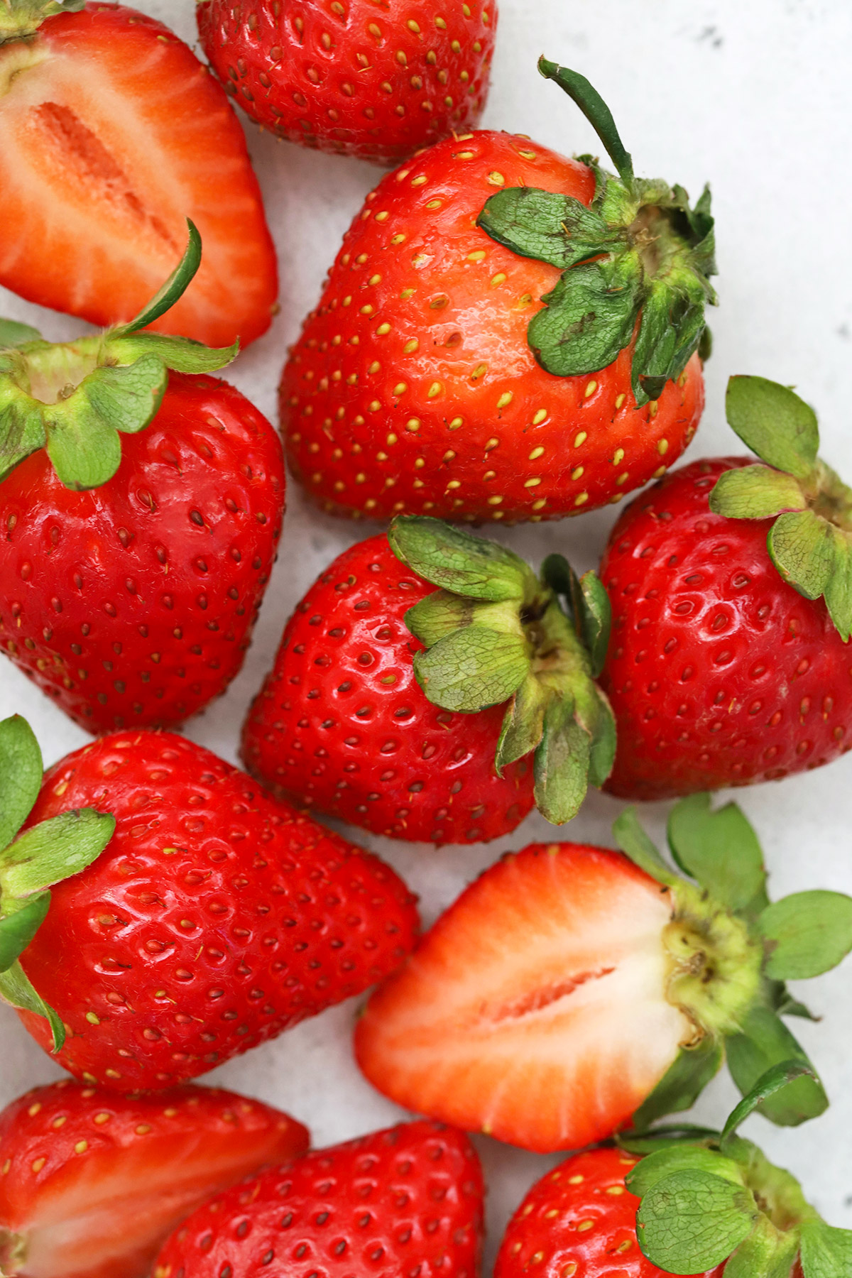 Close up view of fresh strawberries on a white background