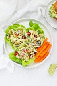Overhead view of curry chicken salad lettuce wraps on a white background