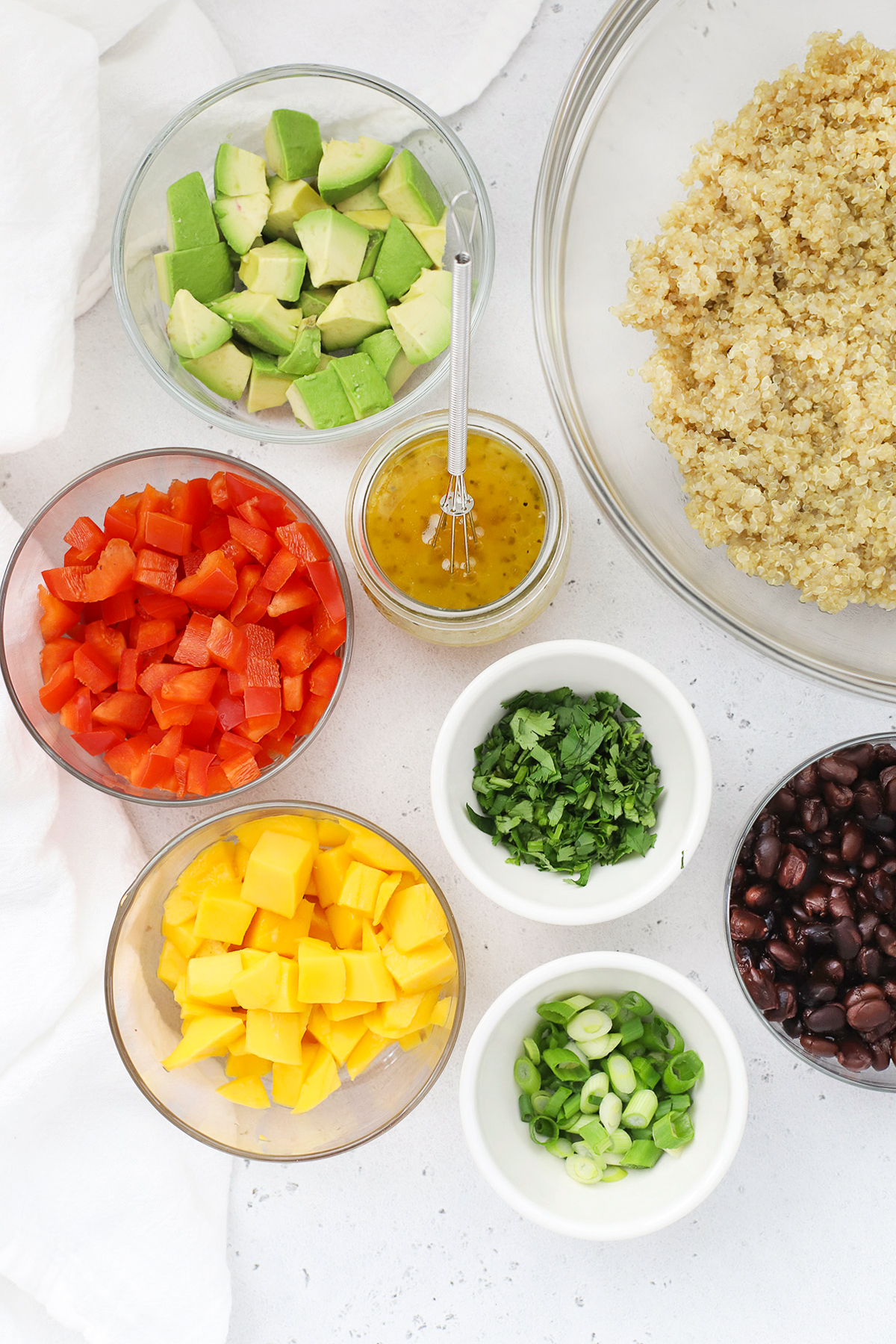 Overhead view of bowls of ingredients for Confetti Quinoa Salad