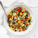 Overhead view of a bowl of Confetti Quinoa Salad in a white bowl on a white background
