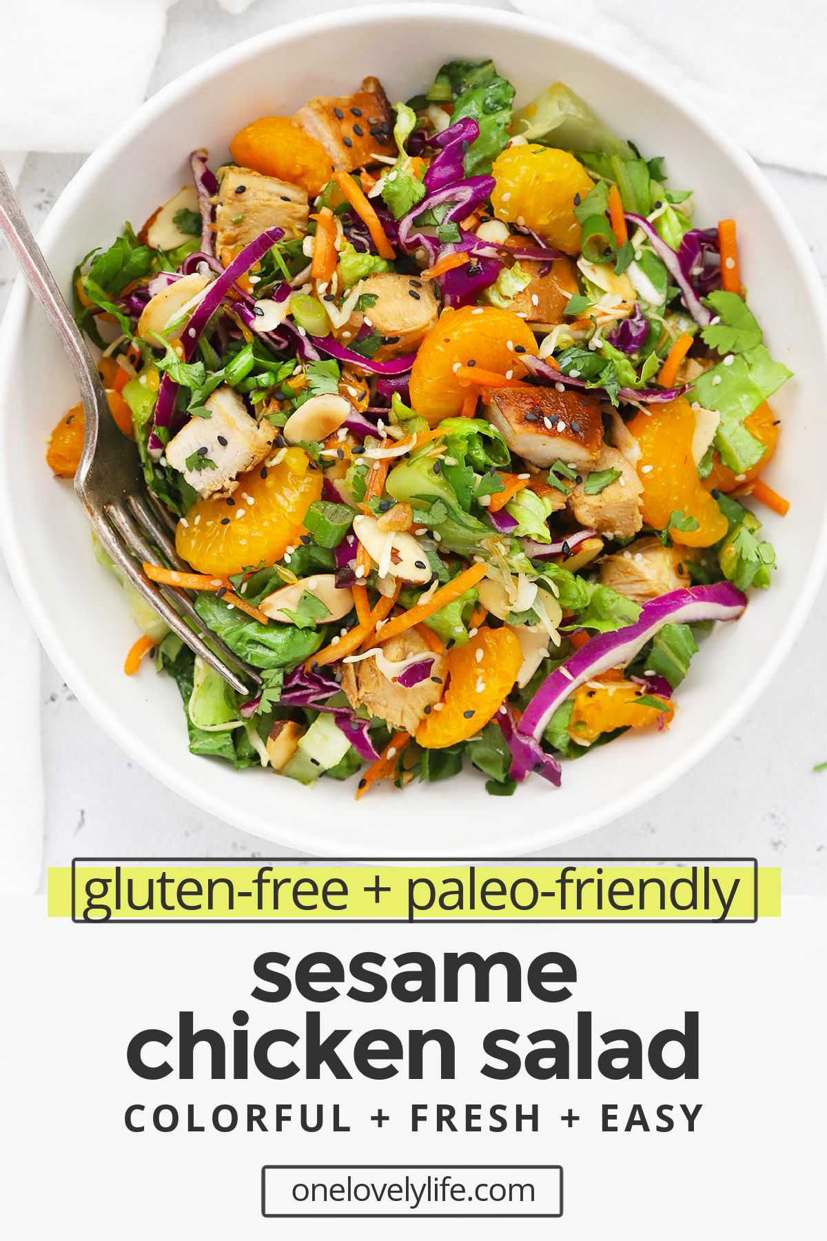 Sesame Chicken Salad - With tender sesame marinated chicken, colorful veggies, and a delicious sesame dressing, this sesame chicken salad is one of our favorite healthy dinners! (Gluten-Free, Paleo-Friendly) // Healthy sesame chicken salad // paleo sesame chicken salad // main dish salad // dinner salad // healthy dinner // healthy lunch #salad #healthydinner #glutenfree