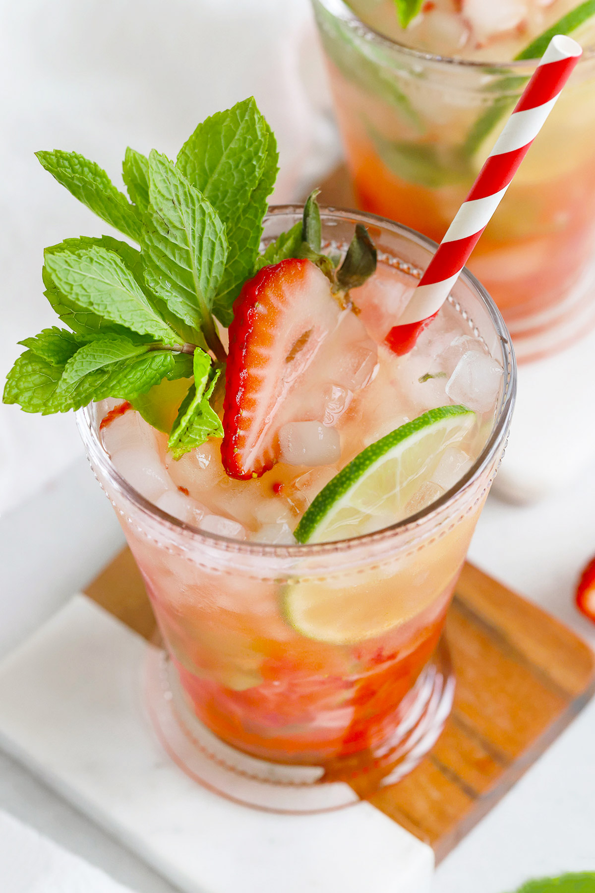 Front view of a non-alcoholic strawberry mint julep mocktail in a glass julep cup