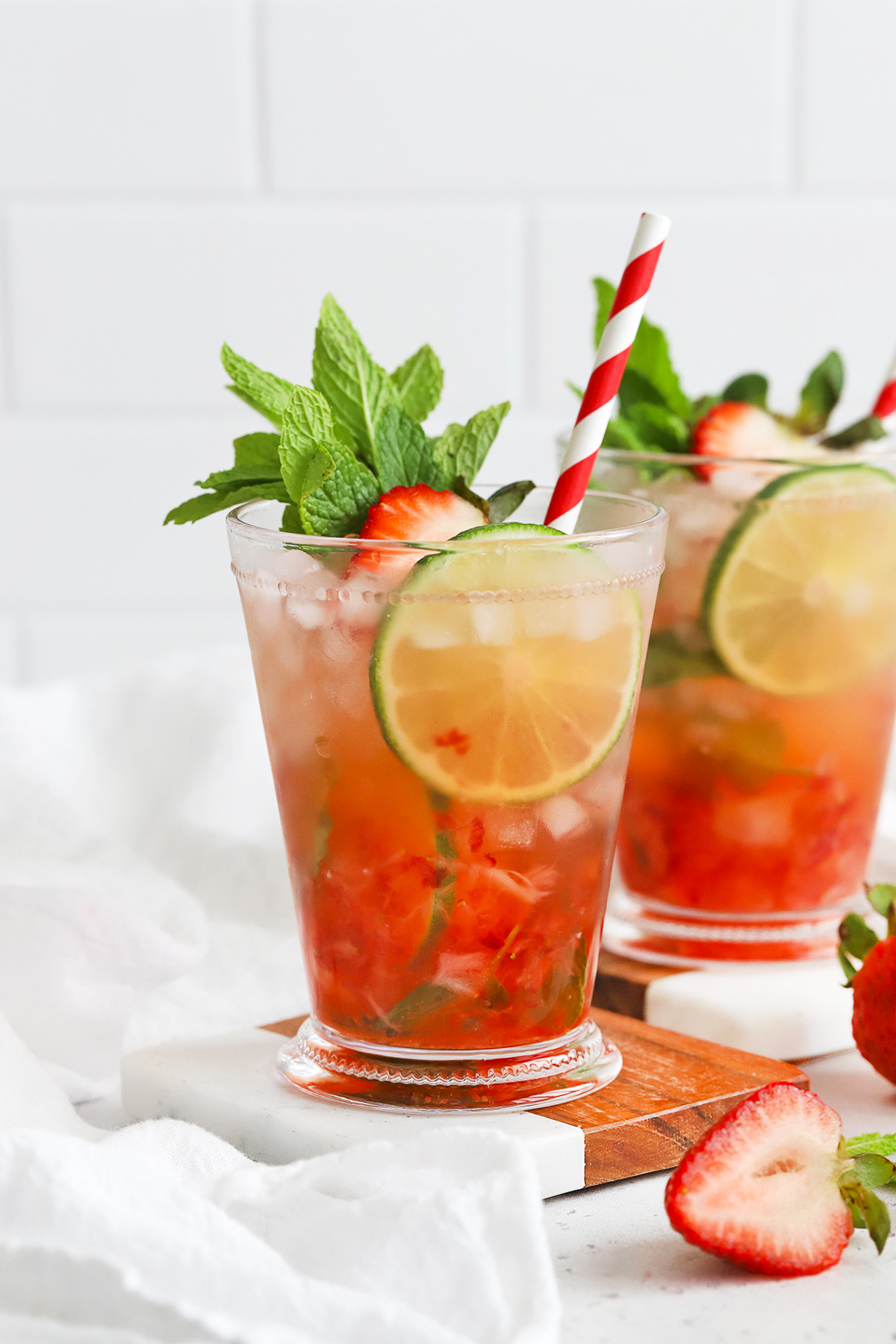 Front view of Non-Alcoholic Strawberry Mint Juleps on coasters