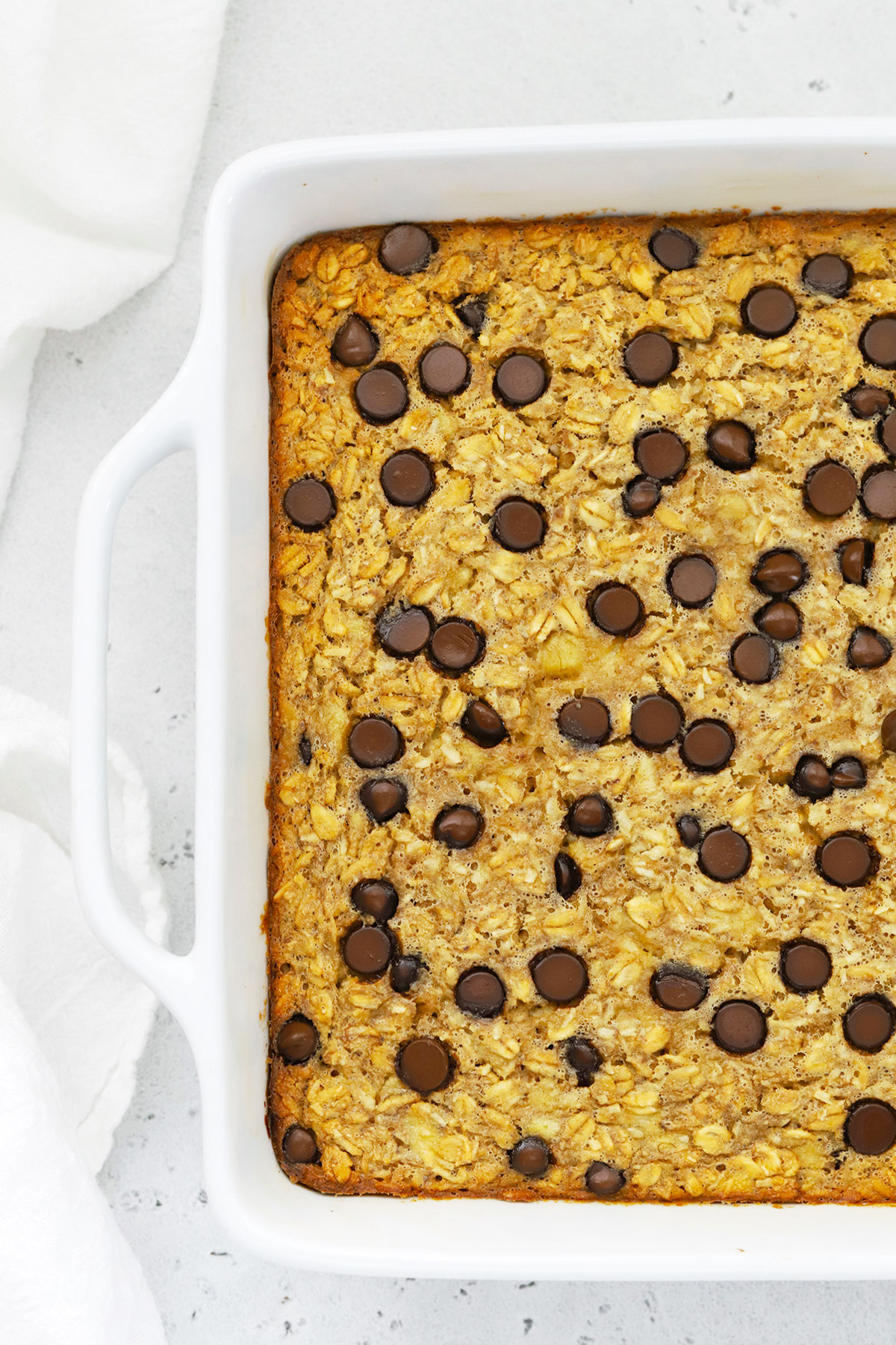 Overhead view of a pan of Chunky Monkey Baked Oatmeal fresh out of the oven