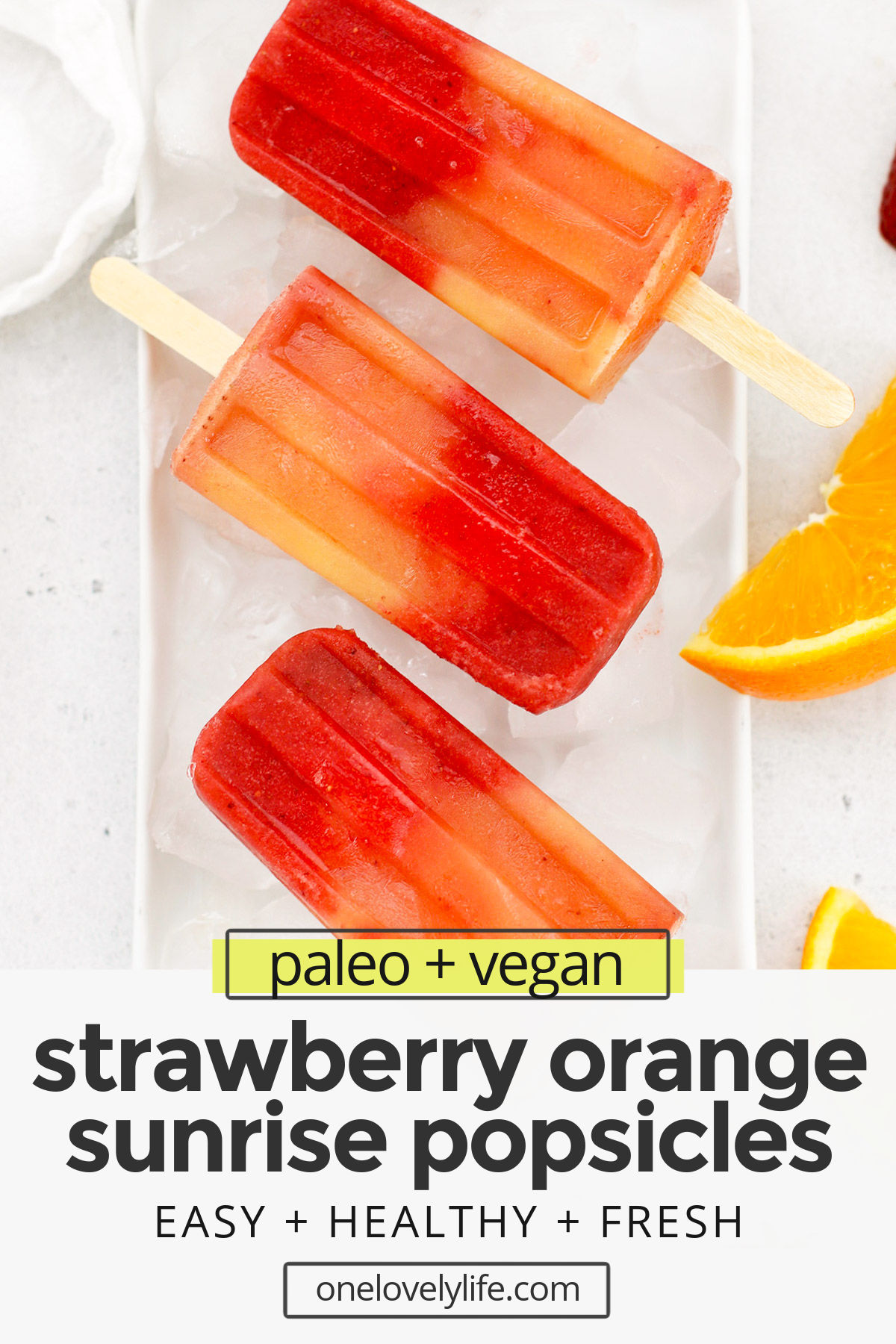 Strawberry Orange Sunrise Popsicles - These pretty orange strawberry popsicles are naturally sweetened & perfect for summer! (vegan & paleo) // Strawberry Orange Popsicles // Healthy Popsicles // Vegan Popsicles // Paleo Popsicles // Smoothie Popsicles #popsicles #icepops #summertreat #paleo #vegan #glutenfree