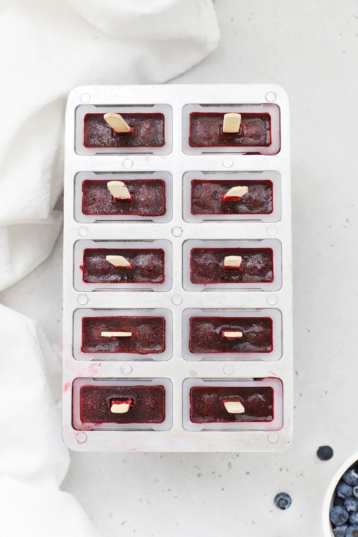 Overhead view of blueberry pomegranate popsicles in the popsicle mold