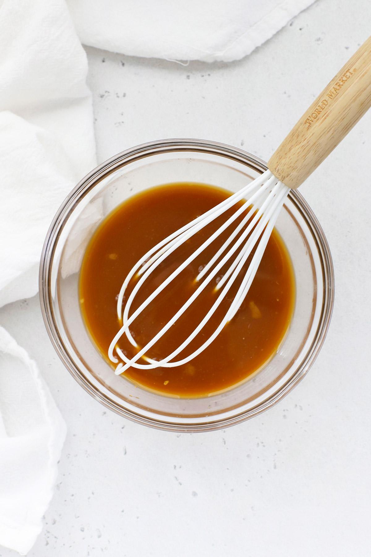 Overhead view of orange chicken stir fry sauce