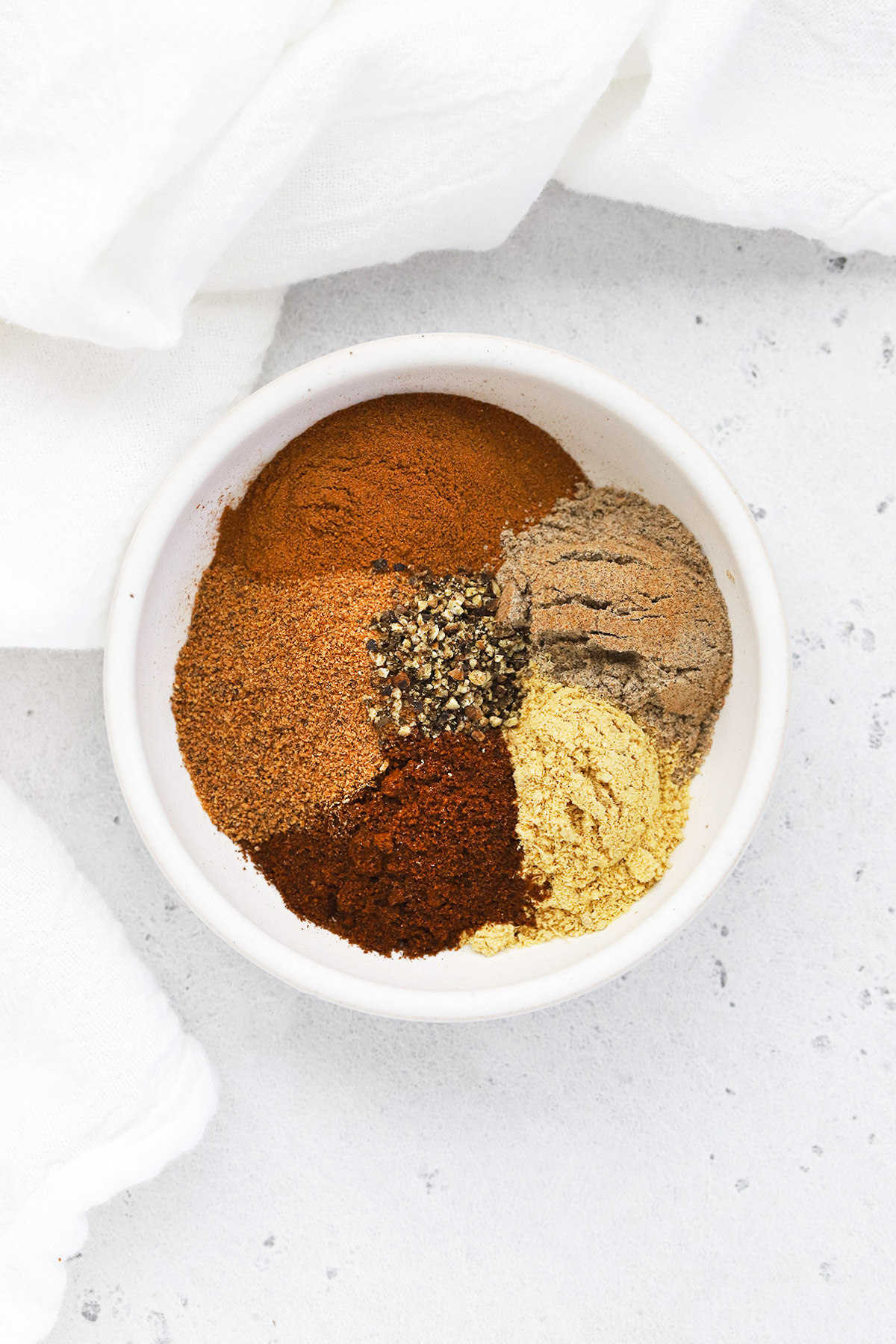 Overhead view of a bowl of homemade chai spice mix from scratch