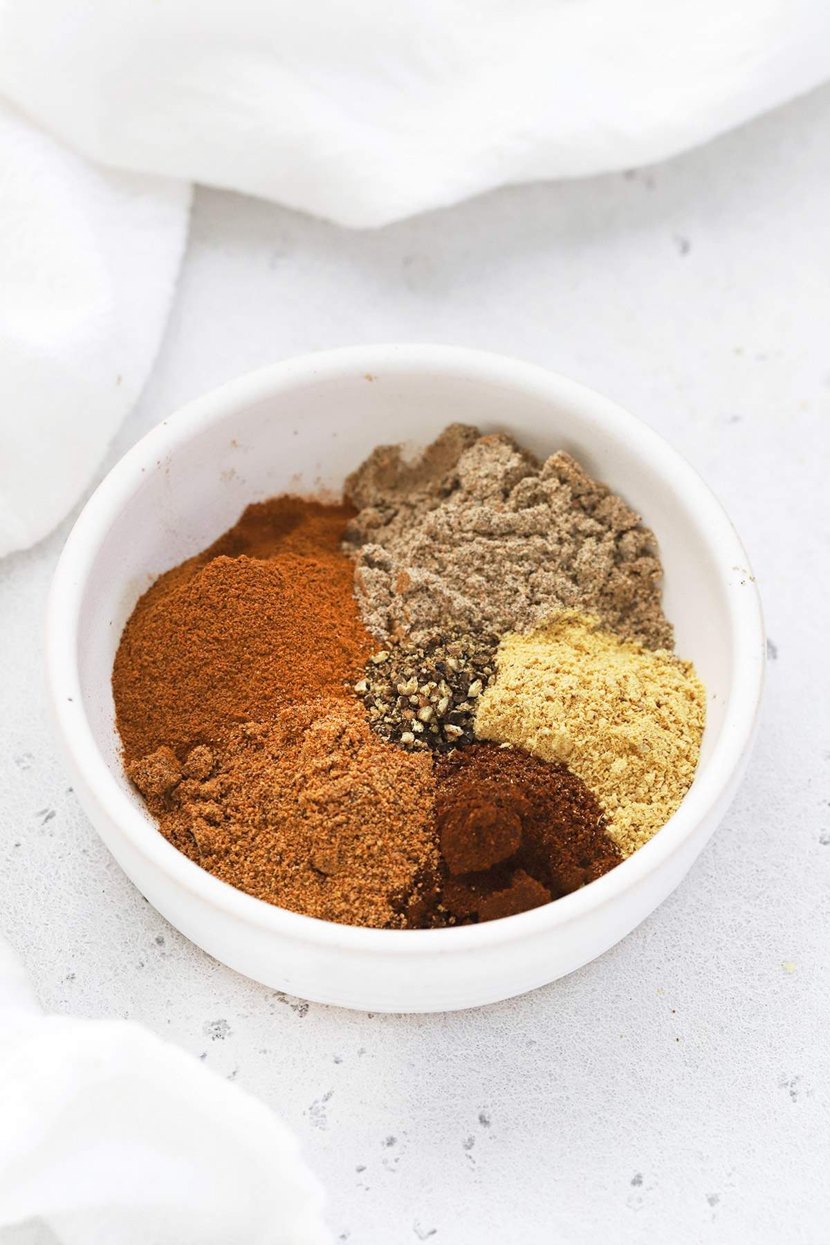 Front view of a bowl of homemade chai spice mix from scratch