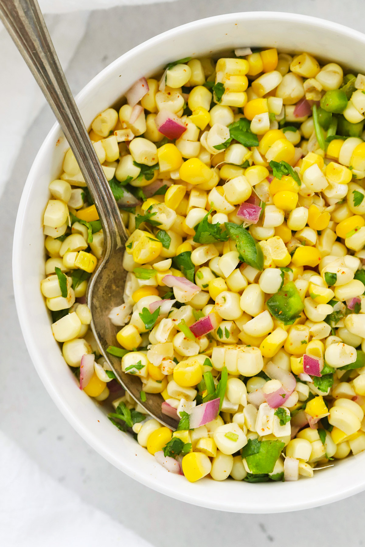 Close up view of chipotle copycat fresh corn salsa