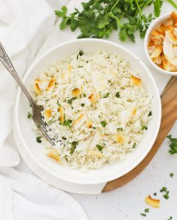 Overhead view of fluffy Instant Pot Coconut Rice garnished with toasted coconut and cilantro