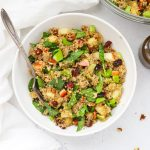 Overhead view of a bowl of healthy powerhouse quinoa salad with balsamic dressing
