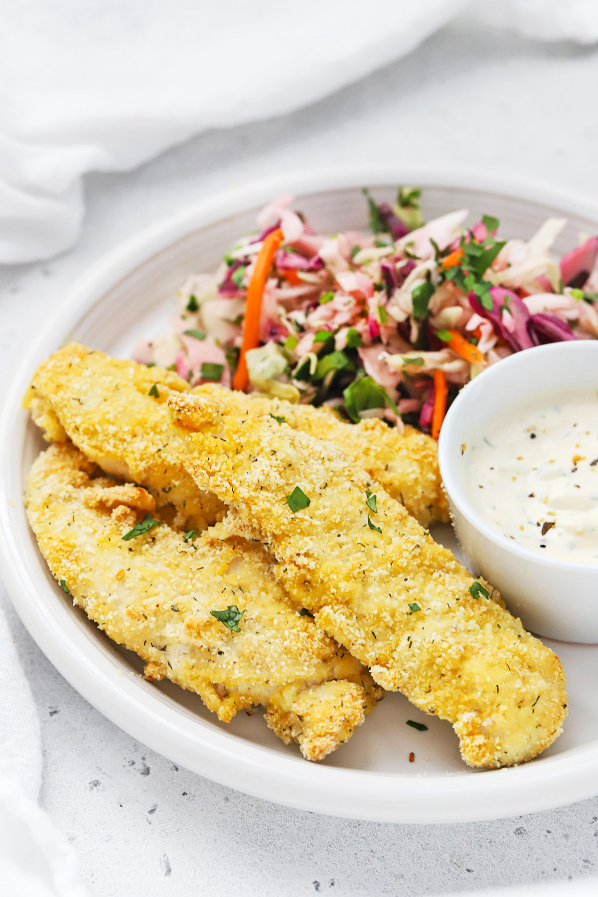 Paleo Almond Flour Chicken Tenders with ranch and cilantro lime slaw