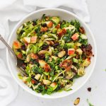 Overhead view of Harvest Apple Kale Brussels Sprouts Salad with Balsamic-Herb Dressing