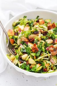 Front view of Harvest Apple Kale Brussels Sprouts Salad with Balsamic-Herb Dressing