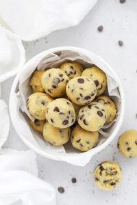 Close up view of a bowl of healthy edible cookie dough bites with chocolate chips