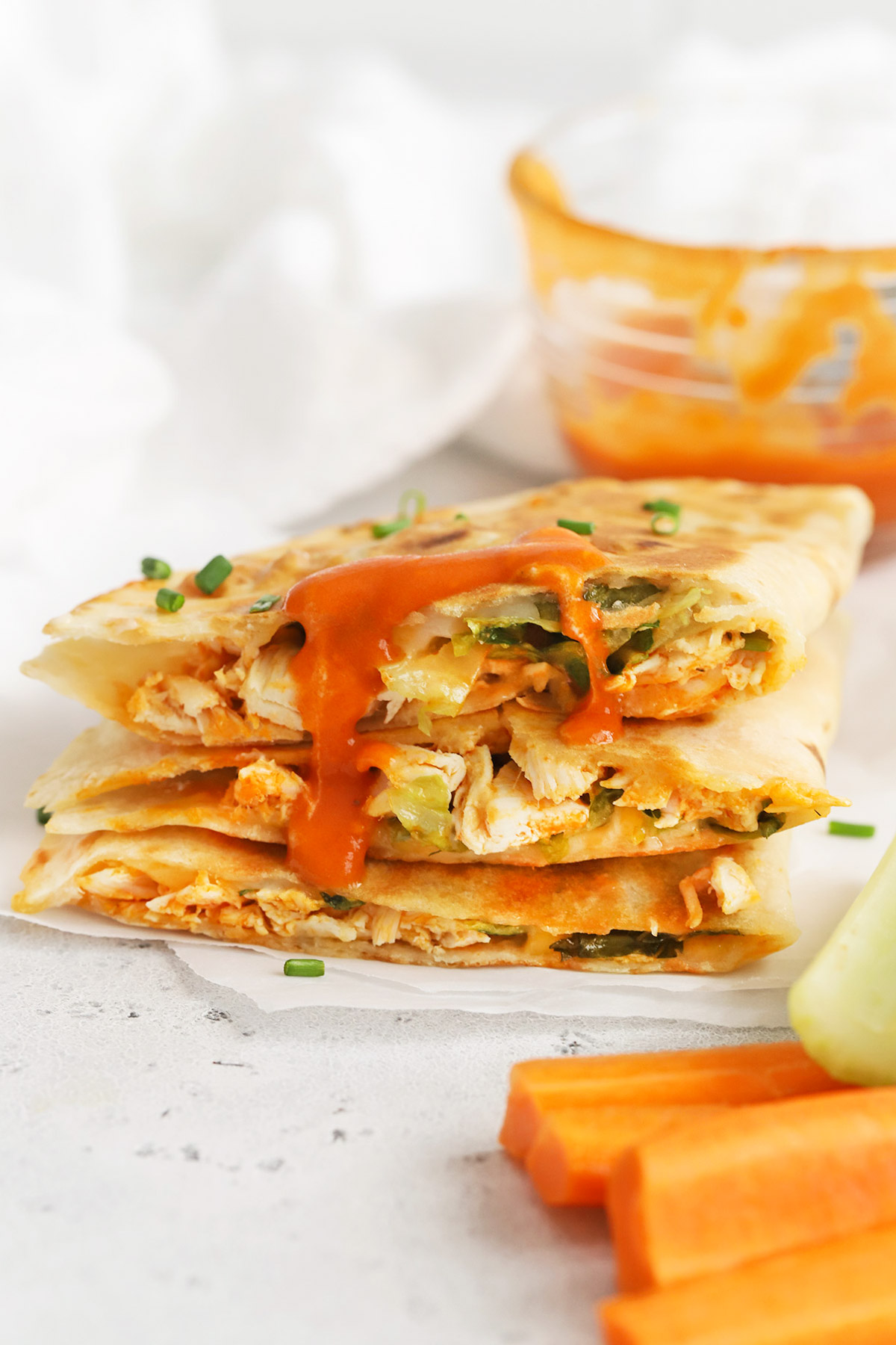 Front view of buffalo chicken quesadillas cut into quarters