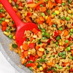 Close up Overhead view of a pan of healthy vegetarian fried rice with colorful veggies